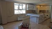 بازسازی ساختمان مهرشهر کرج - اتاق پذیرایی و آشپزخانه